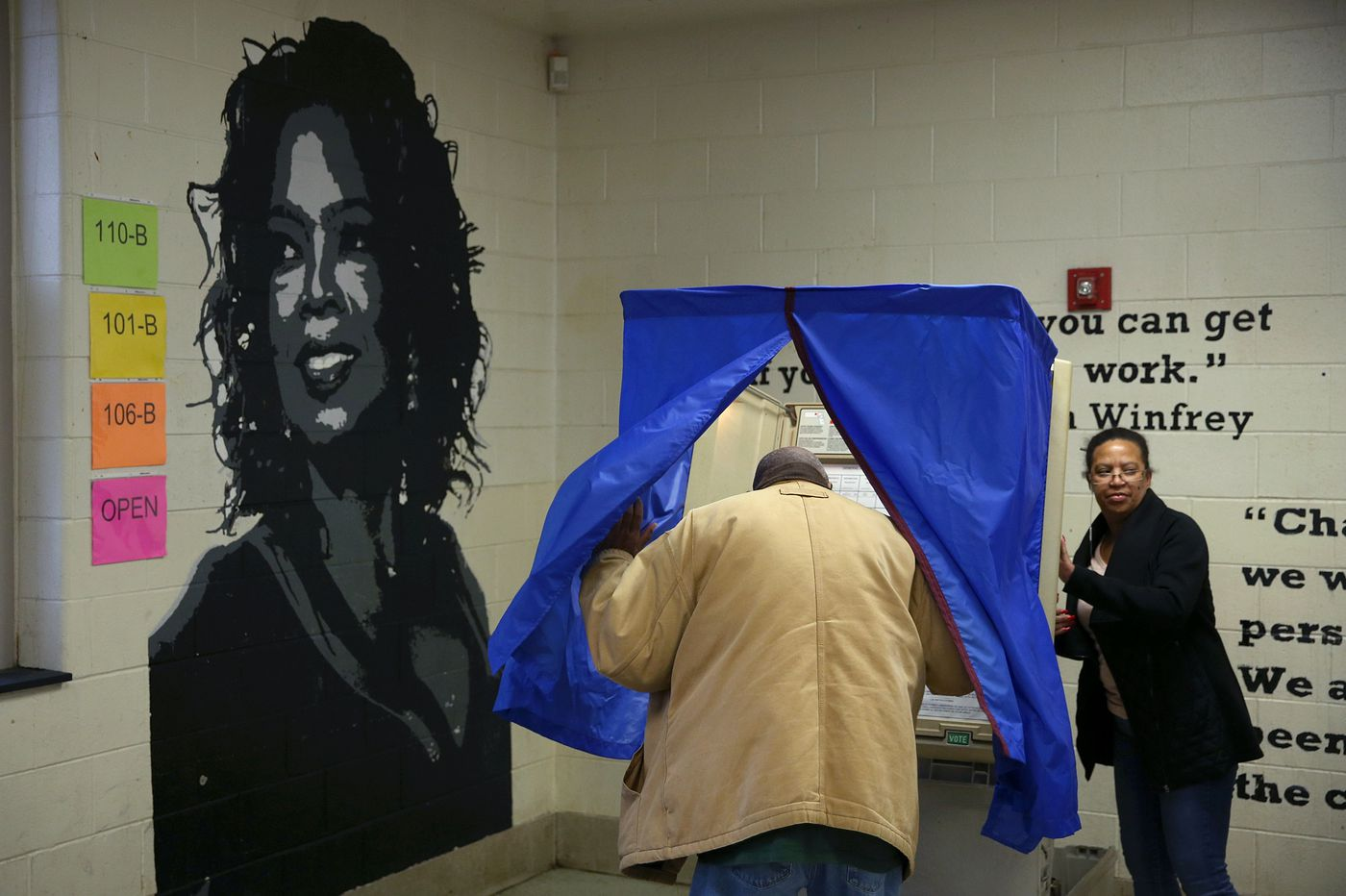 Election Day in pictures: Our photographers capture voters at the polls