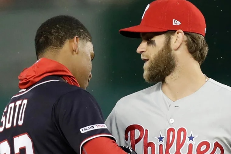 The Phillies' Bryce Harper, right, and Washington Nationals right fielder Juan Soto are two of the best players in the National League East.