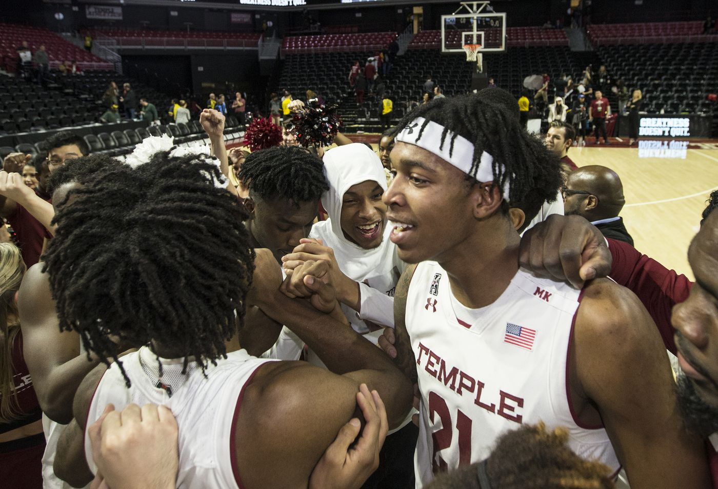 276cd6ed657 Justyn Hamilton, right, and the Temple team huddle after their victory over  Connecticut at