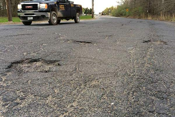 Working to repair Glouco's Paradise Road for its new role