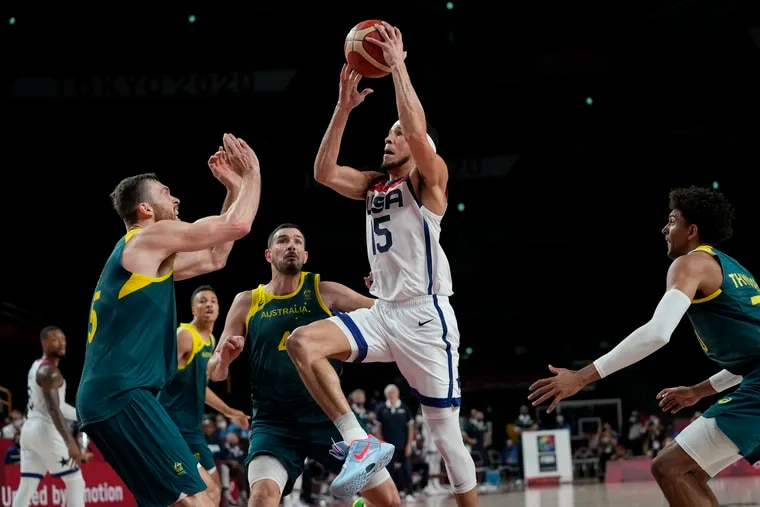 Devin Booker (15) drives to the basket during the U.S. men's basketball team's semifinal win over Australia.