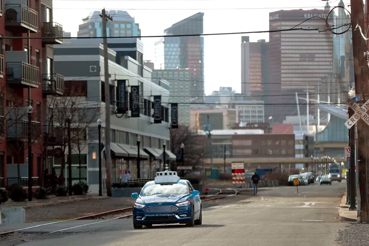 One of the test vehicles from Argo AI, Ford's autonomous vehicle unit, navigates through the strip district near the company offices in Pittsburgh. Argo AL has been among the busiest testers of self-driving vehicles in Pennsylvania.