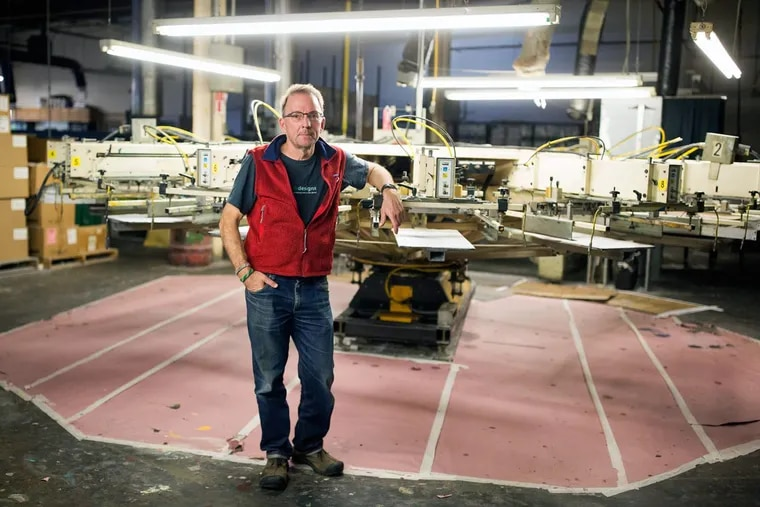 Eric Henry, owner of TS Designs, stands in the facility where he prints T-shirts in Burlington, N.C. He said he's felt little effect from the state tax cuts Republicans enacted there beginning in 2013.