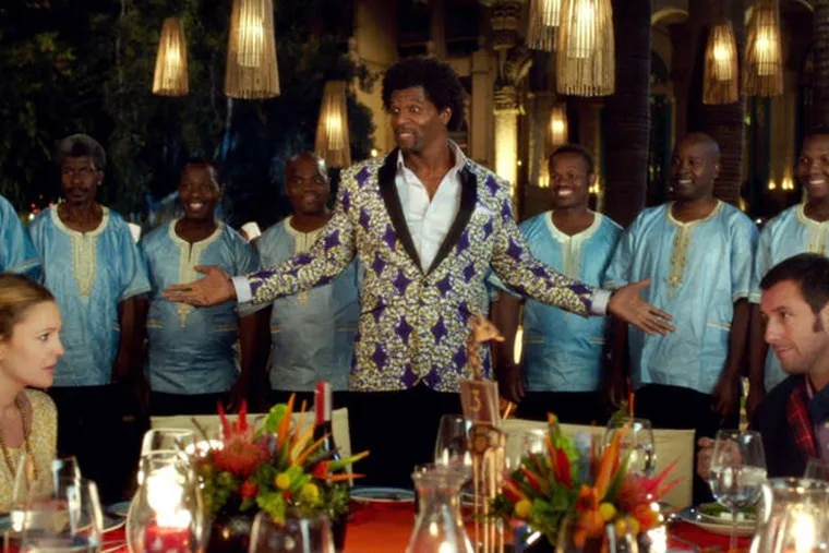 """Drew Barrymore as Lauren, Terry Crews as Nickens with backup singers Thathoo played by Junior Mambazo and Adam Sandler as Jim in Warner Bros. Pictures' romantic comedy """"Blended,"""" a Warner Bros. Pictures release."""