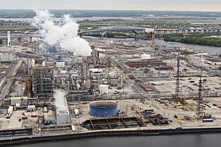 The Sunoco refinery along the Schuylkill. The 1,400 acres spark in dreamers grand visions of new land uses, but a city official says that given the site's history, industrial or commercial activities make more economic sense. MICHAEL BRYANT / Staff Photographer