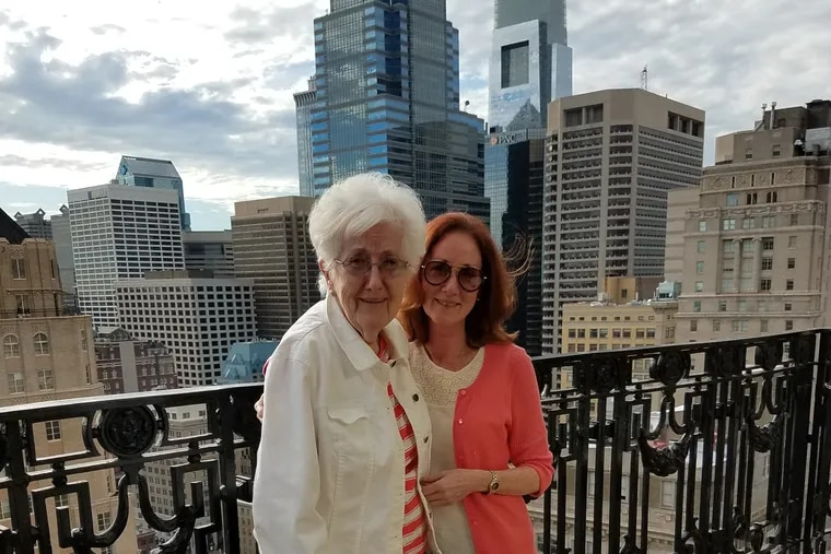 The author, together with her mother, Audrey, in healthier times (June 2017), on the balcony of XIX at the Hyatt at the Bellevue, Philadelphia, the weekend of Audrey's 80th birthday celebration.