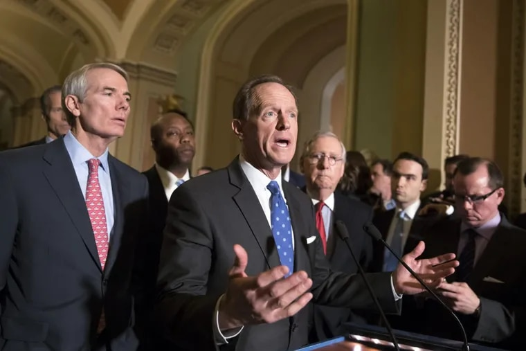 Sen. Pat Toomey (R., Pa.), center, joined by, from left, Sen.Rob Portman (R., Ohio), Sen. Tim Scott (R., S.C)., and Senate Majority Leader Mitch McConnell (R., Ky.), talks about the Republican tax bill.