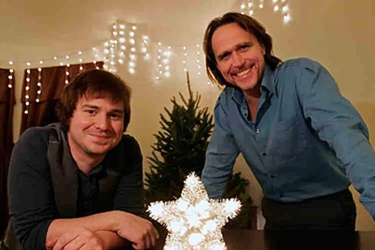 """For roommates Jeff Barrett (left) and Stephen Lyons, being dateless makes it the season of stress. """"Things become very tense around the mistletoe,"""" says Lyons. (Michael Bryant/Staff)"""