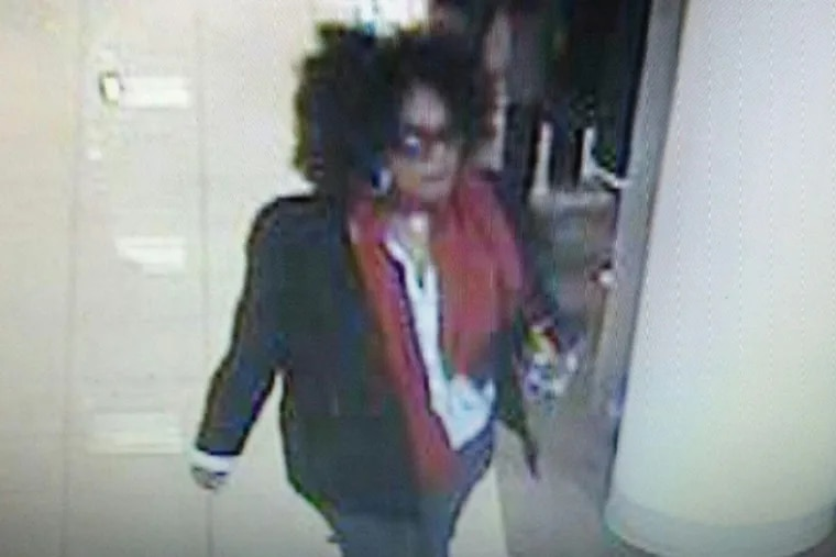 The suspected biter is described as a black female in her mid-30s with a heavy-set build and thick, curly hair. She possibly operated an older model Audi sedan, dark in color.