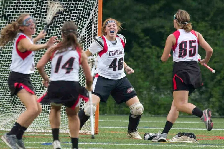 Archbishop Carroll goalie Nora McGeever (46) leads the celebration after the Patriots beat Archbishop Wood for the Catholic League girls' lacrosse championship at Neumann University. Carroll raced to a 10-3 advantage in the first half.
