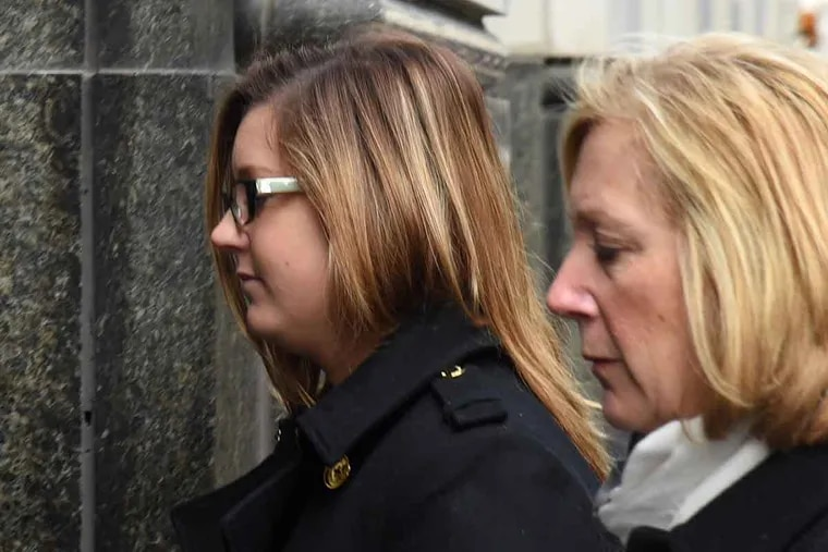 Kathryn Knott, 25, of Bucks County, who was convicted by a Philadelphia Common Pleas jury in December of four misdemeanor counts in the Sept. 11, 2014, attack on a gay couple in Center City, arrives at the Criminal Justice Center with her mother, Carol Knott, for sentencing.