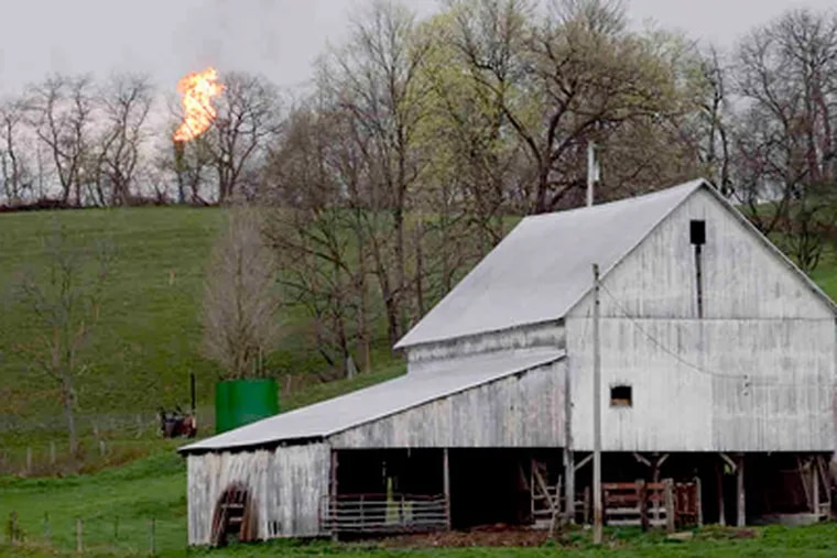 A flare stack sits atop a hill at the site of the Range Resources Ltd. Durkacs' gas well in Chartiers Township in western Pennsylvania's Washington County.