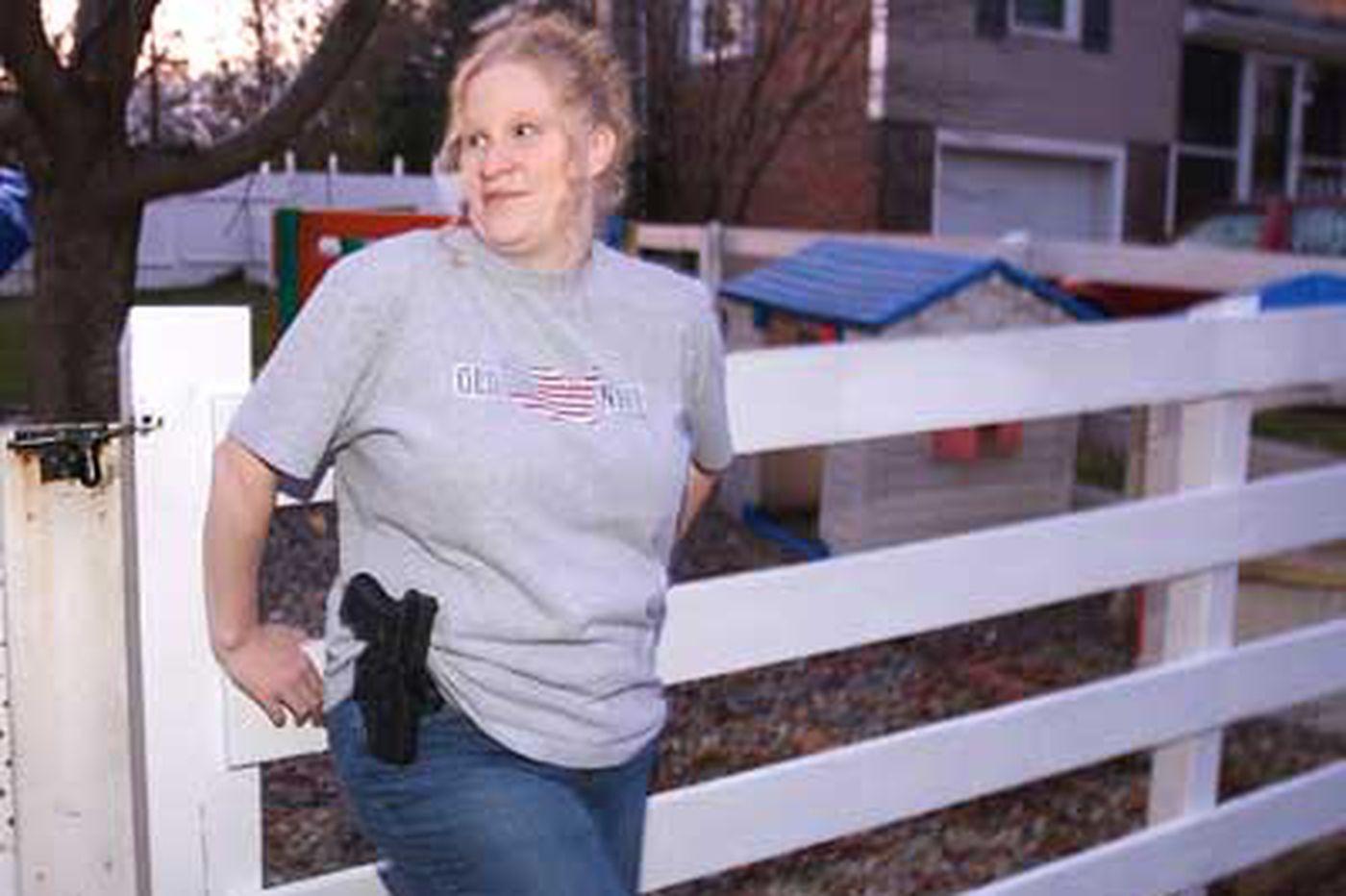 Gun-toting woman divides community