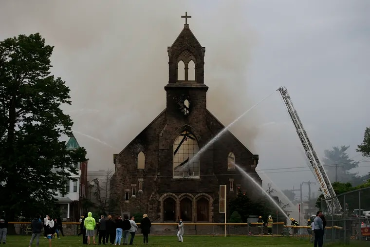 Philadelphia firefighters work to douse the flames at St. Leo the Great Catholic Church in the Tacony neighborhood on May 9.