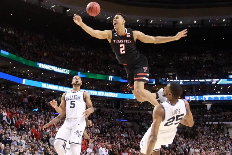 Zhaire Smith cannot finish the dunk over Mikal Bridges during the 2017-18 college season.