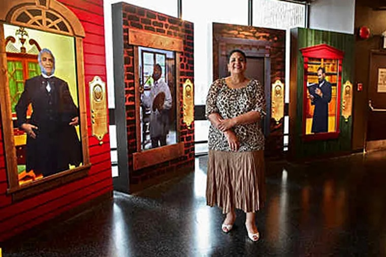 """At the African American Museum in Philadelphia, its chief, Ramona Riscoe Benson, amid part of the permanent show, """"Audacious Freedom: African Americans in Philadelphia, 1776-1876."""" (David M Warren / Staff)"""