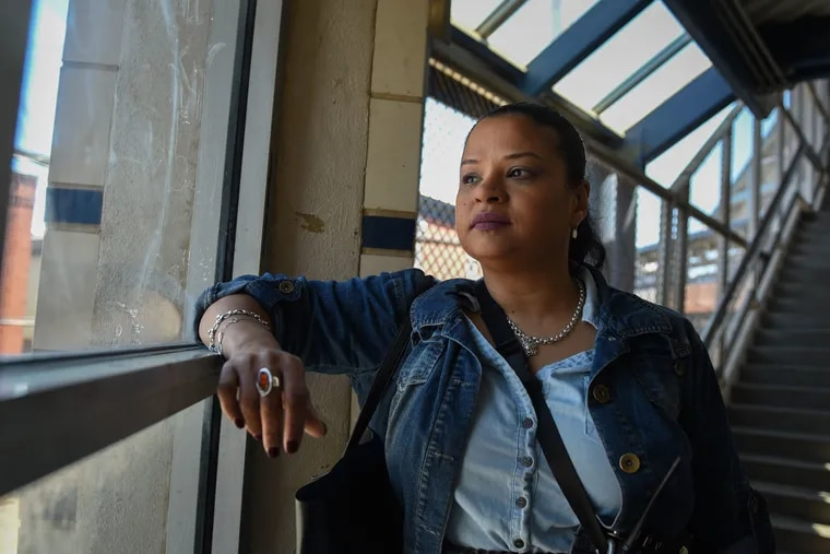 Roz Pichardo looks out the window at Kensington Avenue from inside the Somerset El station on April 27, 2019. Pichardo is a Kensington resident who works in the harm reduction community in the neighborhood.
