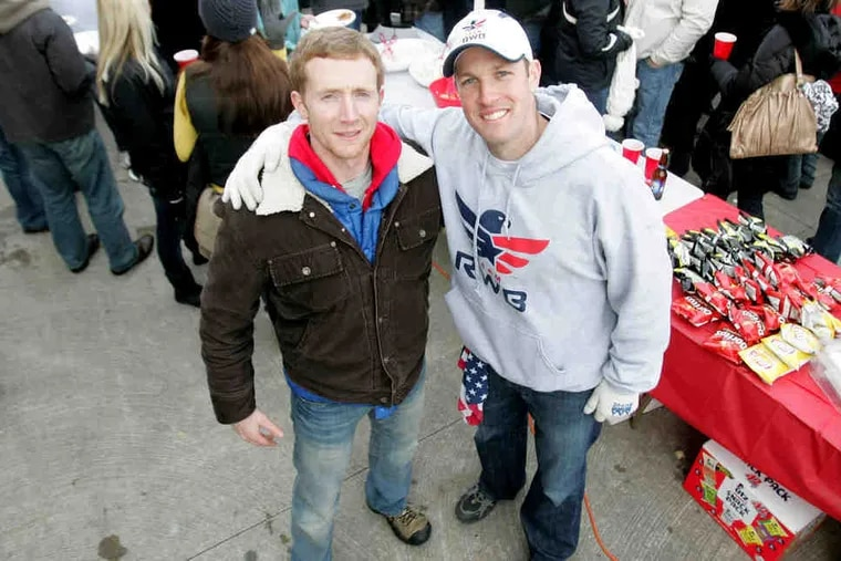Sam Linn and Mike Erwin (right) at the tailgate fund-raiser at the Army-Navy game. They aim to assist veterans reentering society.