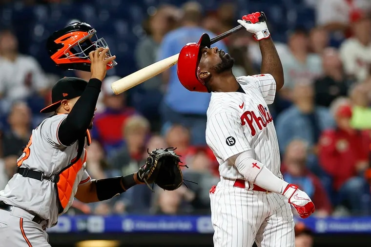 Phillies Andrew McCutchen watches his pop-up for the final out of the game against Baltimore Orioles catcher Pedro Severino on Monday, September 20, 2021 in Philadelphia.