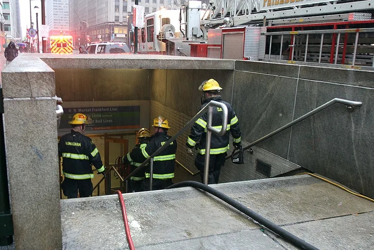 Firefighters enter the Suburban Station concourse to investigate a fire on January 18, 2015.  The station was closed after smoke filled the concourse. DAVID MAIALETTI / Staff Photographer