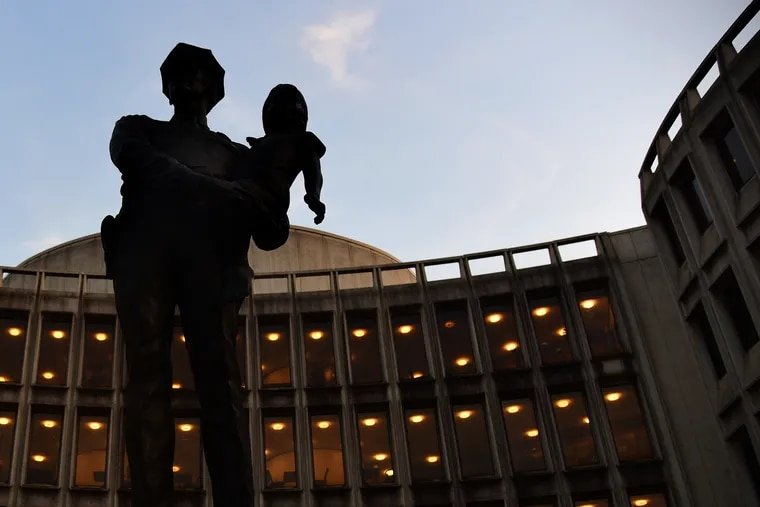 """The iconic """"A Friend"""" statue by Wilmington, Del., artist Charles Cropper Parks outside the Philadelphia Police Administration Building at Race and Arch Streets."""