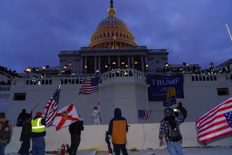 Demonstrators at the Capitol Building in Washington, D.C. on January 6, 2021. After police dispersed rioters with tear gas, after the United States Capitol Building was breached by Pro Trump supporters.
