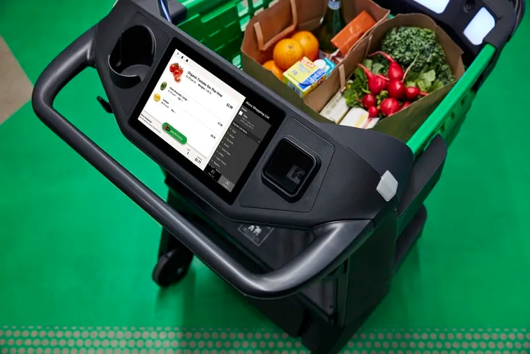 A sensor-equipped shopping cart tallies purchases and bills shoppers later through the Amazon app, eliminating the need for the traditional checkout process on limited quantities of groceries. Kroger has begun trials with another kind of smart cart.