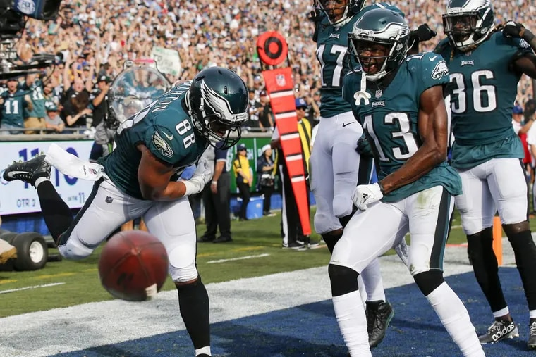 Philaelphia Eagles tight end Trey Burton spikes the football after catching a second-quarter touchdown against the Los Angeles Rams.