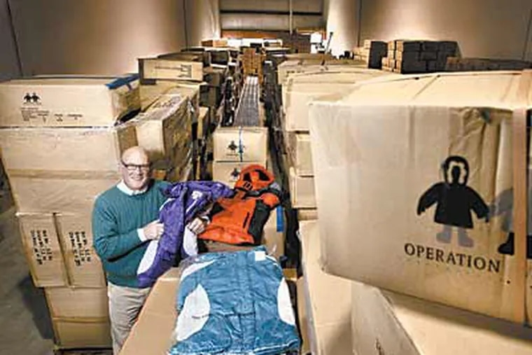 Dick Sanford, founder of Operation Warm, in a Kennett Square warehouse with 9,000 newly-arrived winter coats. ( Michael S. Wirtz / Staff Photographer )