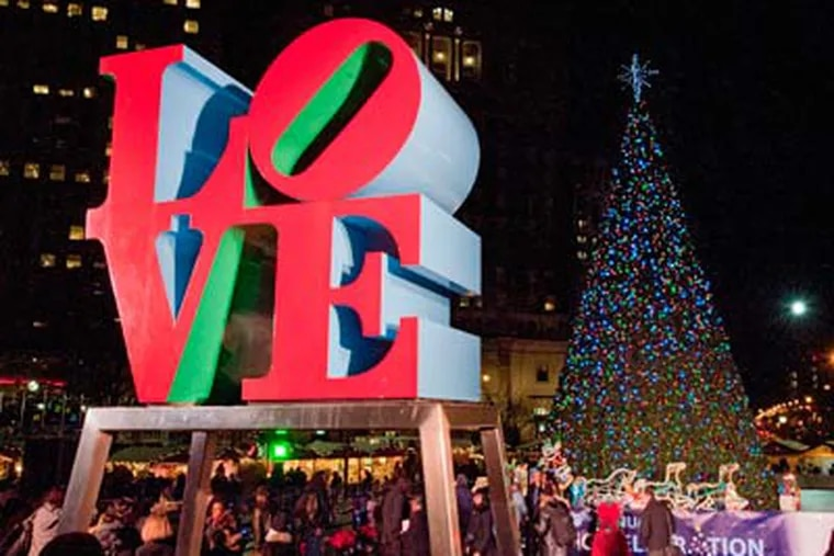 Philadelphia's Christmas tree shines brightly in LOVE Park after the lighting ceremony.  (Clem Murray / Staff Photographer)