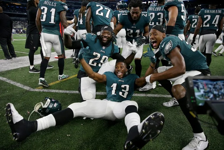 Eagles left to right: LeGarrette Blount, Nelson Agholor, Patrick Robinson, and Rasul Douglas pose on the sideline as the Philadelphia Eagles win 37-9 over the Dallas Cowboys in Arlington, Texas on November 19, 2017.