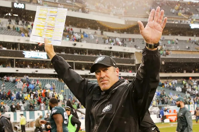 Eagles coach Doug Pederson celebrates his team's 33-10 win over the San Francisco 49ers at Lincoln Financial Field on Sunday.
