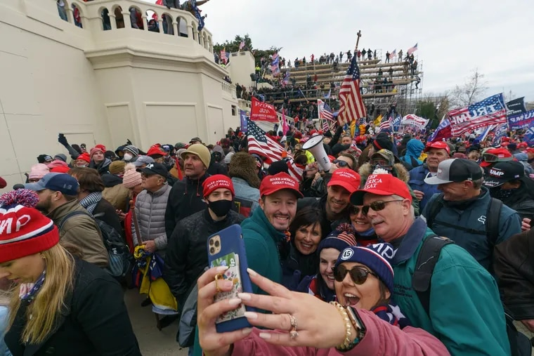 Members of the pro-Trump mob that stormed the Capitol grounds on Wednesday pose for a selfie during the insurrection.