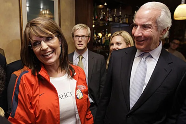 Alaska Gov. Sarah Palin, seen with Ed Snider (right), chairman of Comcast-Spectacor, visited the Irish Pub, on 20th and Walnut streets, last night before the start of the presidential debate. (AP)