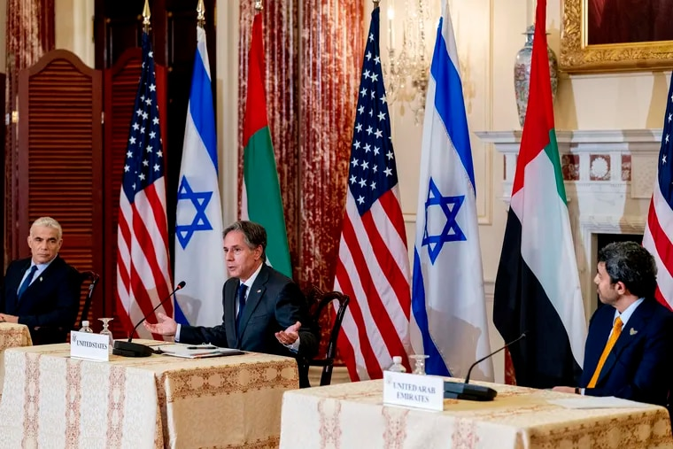 Secretary of State Antony Blinken accompanied by Israeli Foreign Minister Yair Lapid, left, and United Arab Emirates Foreign Minister Sheikh Abdullah bin Zayed al-Nahyanin, right, speaks at a joint news conference at the State Department in Washington, Wednesday, Oct. 13, 2021.