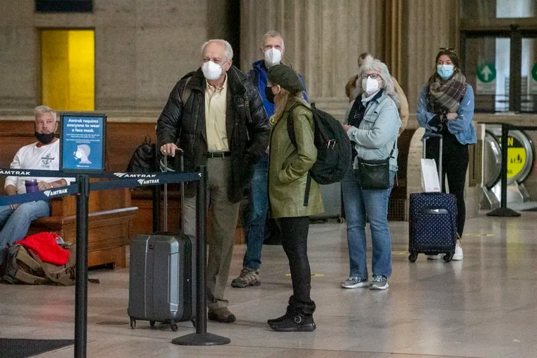 Amtrak passengers wait for their train to start boarding at 30th Street Station on Monday. COVID-19 has affected the Thanksgiving holiday travel season.