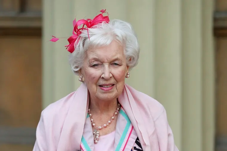 """FILE - Nov. 16, 2017 file photo of Dame June Whitfield after she was made a dame. British actress and comedic star June Whitfield, whose long career included memorable roles in TV series """"Absolutely Fabulous"""" and """"Terry and June,"""" has died. She was 93. (Jonathan Brady/PA Wire/PA via AP, File)"""