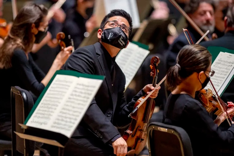 Violinist Daniel Han looks into the audience, onstage with the Philadelphia Orchestra before their Sunday preseason matinee in Verizon Hall.