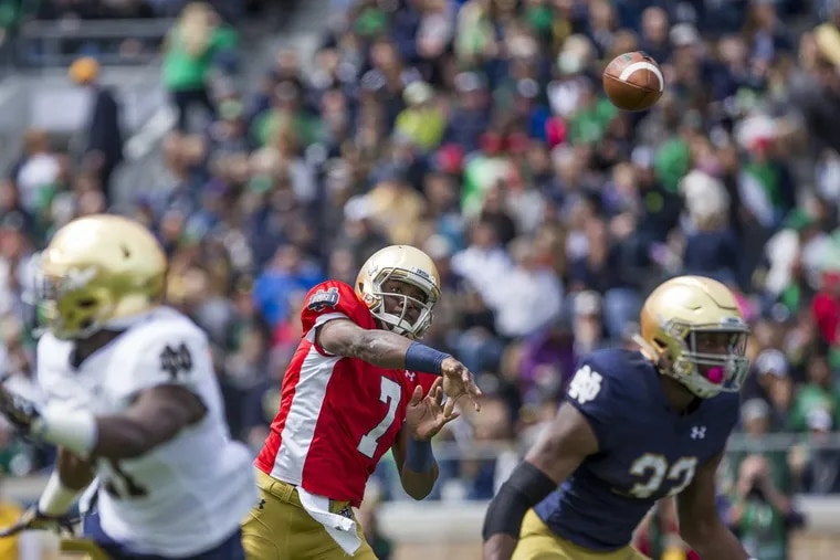 Notre Dame's new starting quarterback, Brandon Wimbush, center, throws during the Notre Dame spring football Blue-Gold game on Saturday, April 22, 2017.