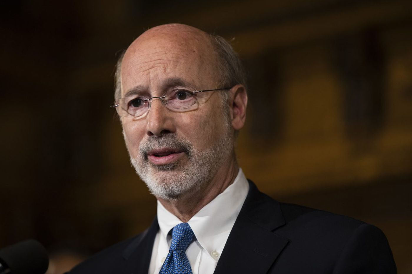 Wolf tight-lipped but optimistic on budget deal
