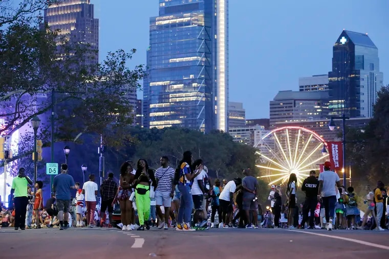 People wait for the last performers on the final day of the 2019 Made in America Festival on the Benjamin Franklin Parkway. For this year's return, the festival will require masks and COVID-safety documentation. *Image not for resale and commercial usage*