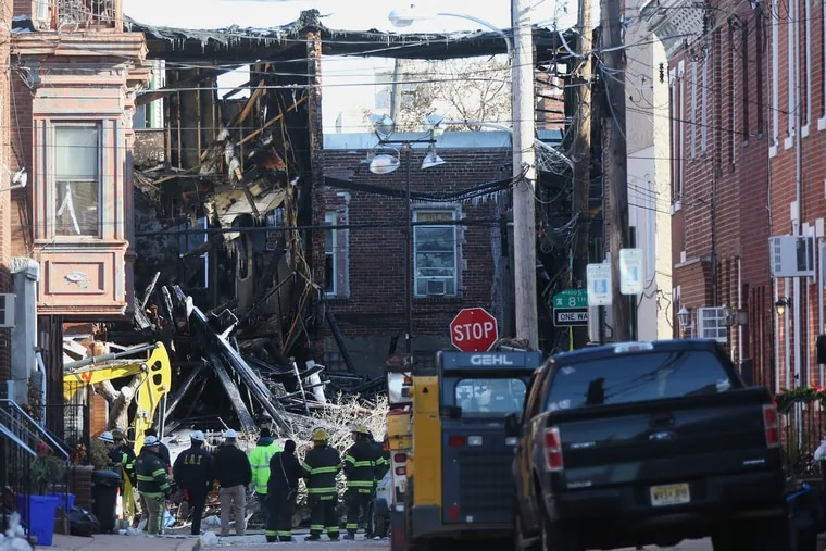 Damage is visible a day after the Dec. 19 explosion and fire on the 1400 block of South 8th Street in South Philadelphia that left two people dead and destroyed several homes.