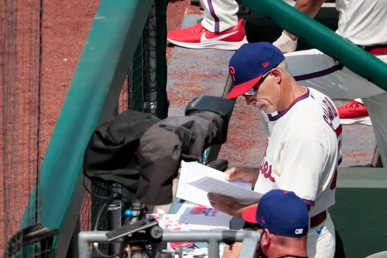 Phillies manager Joe Girardi at work in the dugout on July 26.