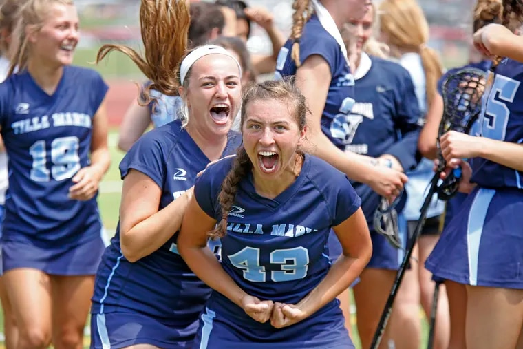 Villa Maria players, including Sarah Delaney (front left) and Maggie Powers (43), celebrate after the Hurricanes won the PIAA Class 2A girls' lacrosse championship.