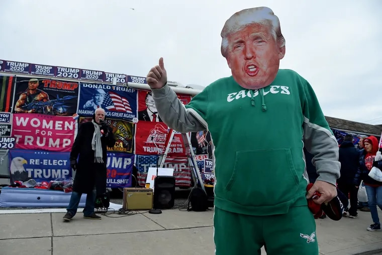 """Rich Duranto, 52, of Ridley pauses.in front of a Trumped-up RV parked in Wildwood selling stuff to supporters before President Donald Trump arrived in Wildwood for a """"Make America Great Again"""" campaign rally on January 28, 2020."""