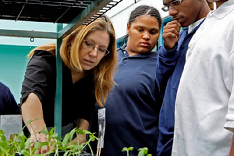 Theresa Mansor offers horticultural tips to students at Atlantic City High.