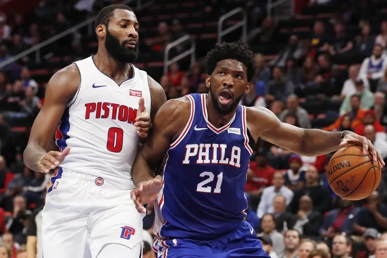 76ers center Joel Embiid drives on Detroit Pistons center Andre Drummond during a game earlier this season.
