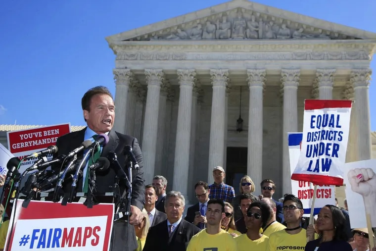 Former California Gov. Arnold Schwarzenegger speaks at a rally for fair elections outside the Supreme Court on  Tuesday.