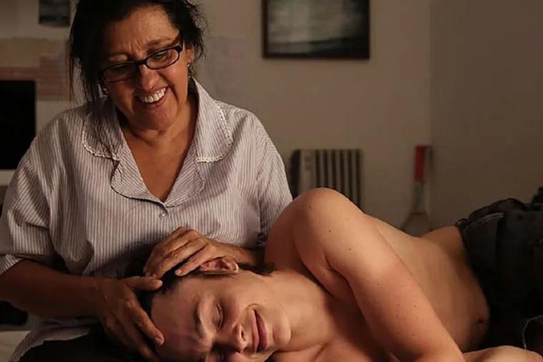 Regina Casé is housekeeper to a family that includes Michel Joelsas as the son. (ALINE ARRUDA /  Oscilloscope)