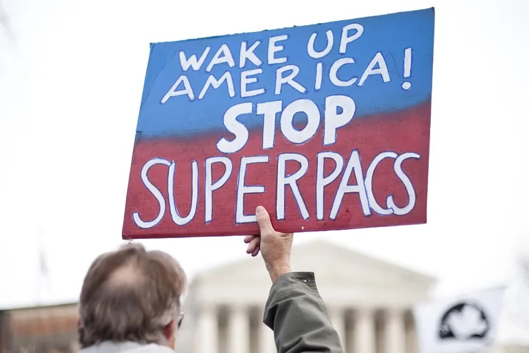 """Move to Amend holds a rally at the Supreme Court to """"Occupy the Courts"""" and mark the second anniversary of the Citizens United v. FEC Supreme Court case on Friday, Jan. 20. 2012."""